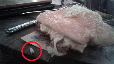 Meal with the bone (circled in image). Photo by Phindiwe Nkosi