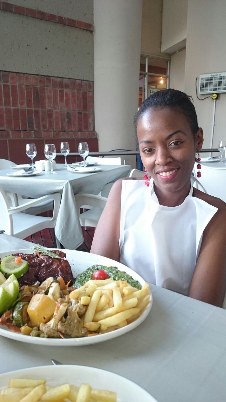 Phindiwe Nkosi with the ribs dish at O'Galito restaurant at Centurion Mall. Photo by SL
