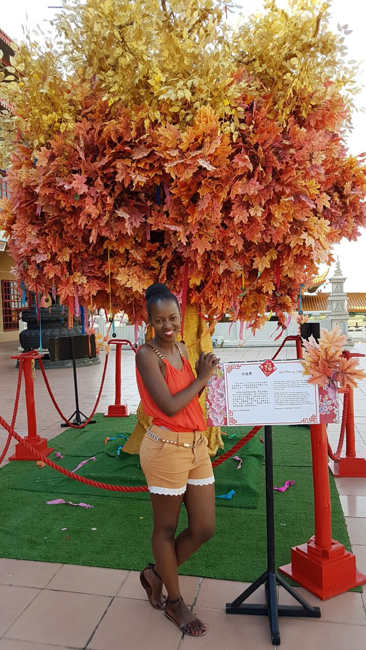 "Phindiwe Nkosi next to the ""Wishing Tree"" at Nan Hua Temple in Bronkhorspruit. Photo by SL"