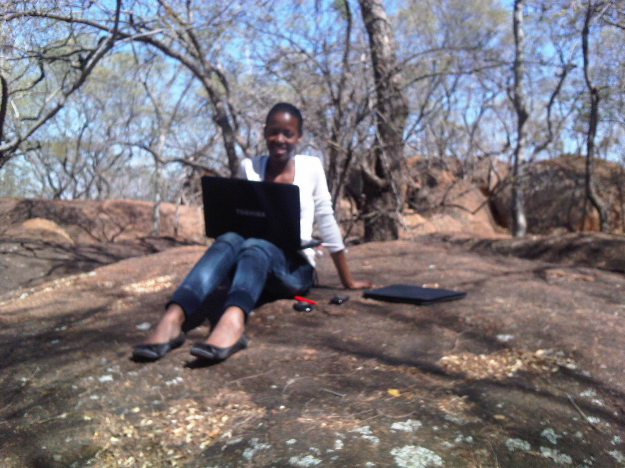 Phindiwe Nkosi on a rock at Dikhololo Game Reserve. Photo by LN.