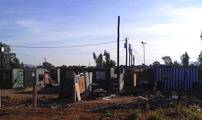 "Shacks and [shipping] ""container homes"" in the northern part of Pretoria, Gauteng. Photo by Phindiwe Nkosi"