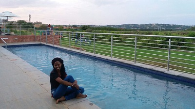 Phindiwe Nkosi at the clubhouse pool overlooking Carlita's Restaurant at The Hills Game Reserve Estate Clubhouse, Pretoria. Photo by S N-B.